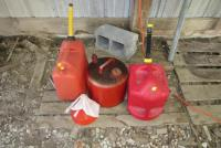 Plastic and metal gas cans