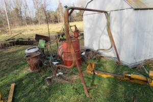 Metal barrels, one with pump (condition unknown)