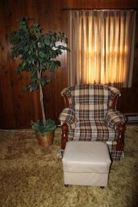 Upholstered armchair, ottoman and artifical ficus