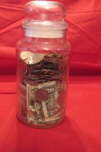 Planters jar of coins