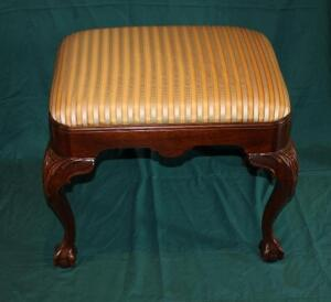 Upholstered claw footed foot stool