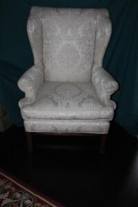 Luttrell upholstered chair with throw pillow