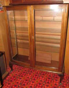 Glass front curio cabinet with glass shelves