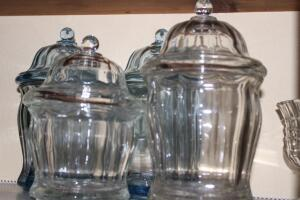 4 glass canisters