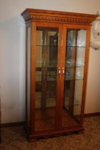 Glass front lighted china hutch with adjustable glass shelves and mirrored back