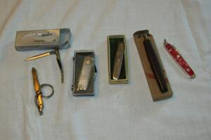 Assortment of pocket knives and Chicago Cutlery sharpening stone