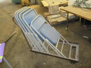 5 padded folding chairs, some with damage