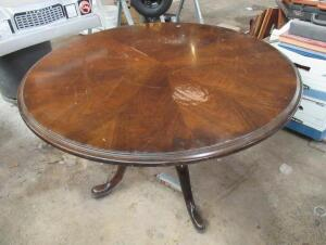 Single pedestal table with some damage to top