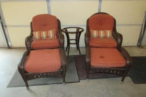 Woven patio swivel chairs, cushions show wear