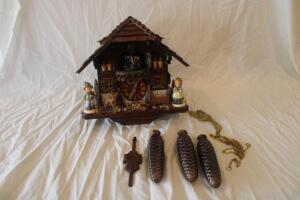 Schneider Cuckoo clock with Hummel figurines
