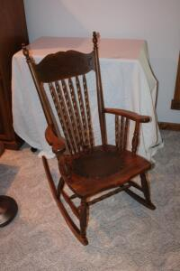 Antique rocker with leather seat