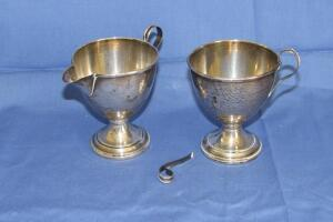 Sterling cement filled base creamer and sugar bowl