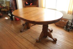 Claw and ball foot pedestal dining table