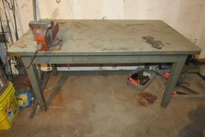 "Metal work bench, shows wear on top, 60"" x 34"" x 31"" T"