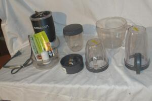Nutri Bullet with mugs, blades