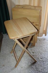 Set of 4 wooden TV tray tables in rack