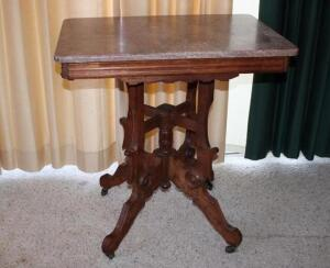 Marble top lamp table on casters, missing finial