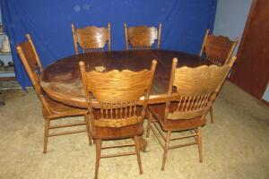 "Single pedestal dining table, 72"" L (includes 24"" leaf) and 6 chairs"