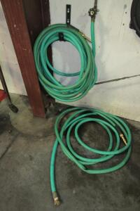 2 garden hoses with nozzles