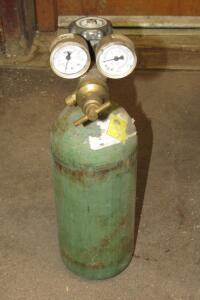 Argon tank with regulator and gauges, some contents