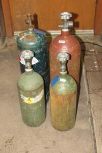 4 acetylene and oxygen tanks, various sizes