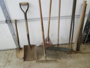 Pick ax, yard rakes and other tools