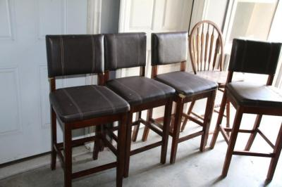 4 upholstered barstools, most with damage
