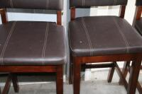 4 upholstered barstools, most with damage - 2
