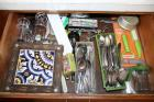 Flatware, salt and pepper shakers, trivet and others