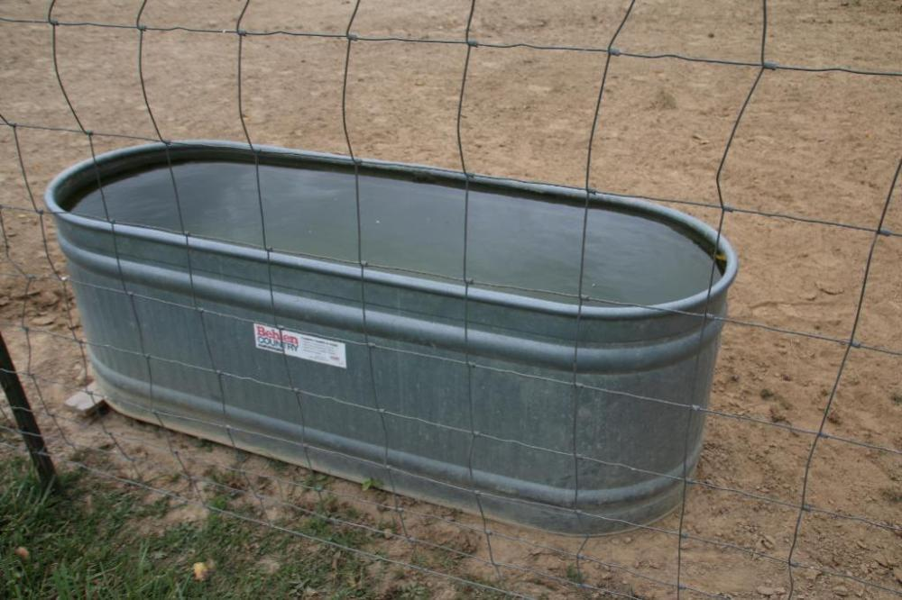 Galvanized water tank used to water mules