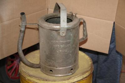"2 gal. liquid ""Swingspout"" oil can"